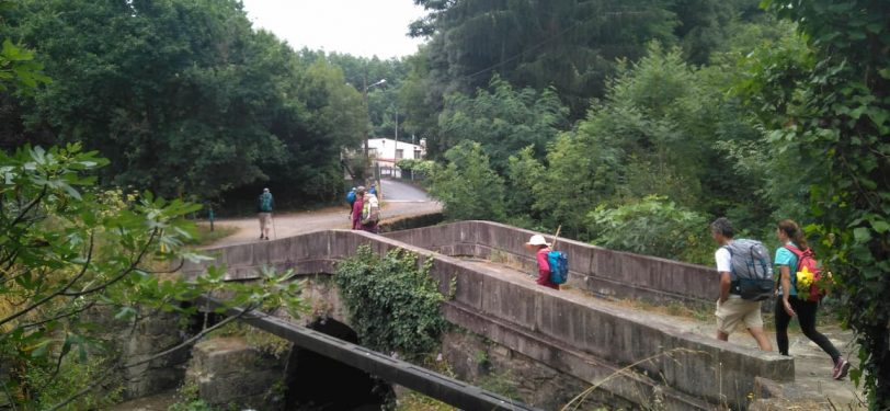Pilgrims crossing bridge Variante Espiritual