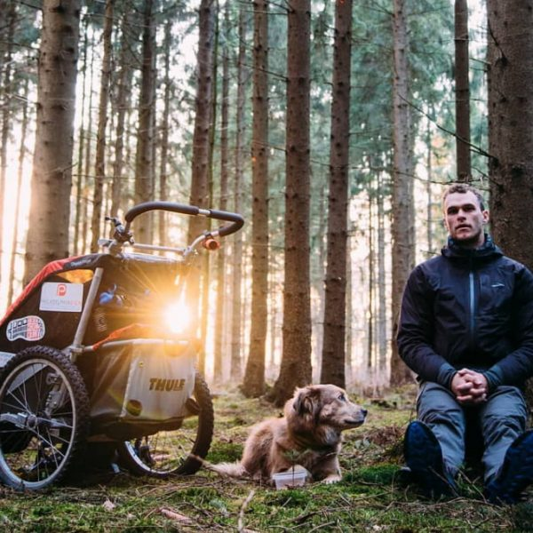 Tom with his dog and trolley in a forest